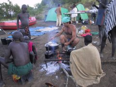 Gary Lemmer cooking for the Mursi in Ethiopia